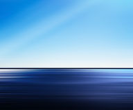 Vivid blue ocean in motion abstraction with light leak Royalty Free Stock Image