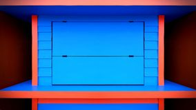 Vivid Blue and Orange Store Counter with Closed Window. Vibrant Blue and Orange Store Counter with Closed Window Royalty Free Stock Images