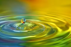 Vivid bright colored water drops freeze instantly Royalty Free Stock Images