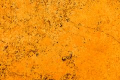 Free Vivid Bright Orange Color Facade Stone Wall With Imperfections And Cracks As Empty Rustic And Simple Background Stock Image - 115661171