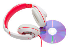 Vivid classic wired headphones and compact disc Royalty Free Stock Photos