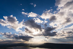 Vivid clouds sun ray Stock Photo