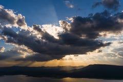 Vivid clouds sun ray Stock Photos