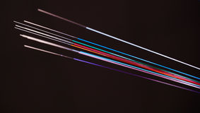 Vivid color coded Optic Fibers on dark background Stock Images