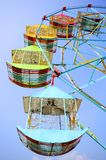 Vivid colored Ferris wheel against the blue sky Royalty Free Stock Image