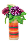 Vivid colored vase with chrysanthemum and dhalia purple flowers, isolated, white background. Royalty Free Stock Image