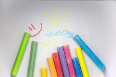 Vivid colorful chalk sticks on a white paper. Beautiful school supplies. Royalty Free Stock Images