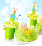Easter eggs with bunny toys Stock Photos