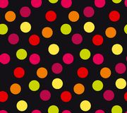 Vivid colorful random polka dot seamless pattern. For wrapping paper, fabric. Abstract classic repeatable motif on black background for surface design Stock Photography