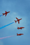 The vivid colors of the red arrows Stock Photo