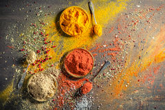 Vivid condiments on old table Royalty Free Stock Images