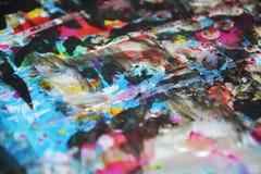 Hypnotic vivid dark blurred colors, contrasts, waxy paint creative background. Vivid dark blue purple blurred watercolor texture. Abstract orange blue dark Royalty Free Stock Photos