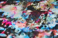 Hypnotic vivid dark colors, contrasts, waxy paint creative background. Vivid dark blue purple watercolor texture. Abstract orange blue dark hypnotic colorful Stock Photos
