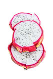 Vivid dragon fruit slices isolated on white background Royalty Free Stock Images