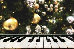 Vivid golden Christmas blur background with piano keys. stock photos