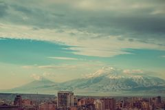 Vivid impression of Yerevan cityscape. Travel to Armenia. Tourism industry. Mount Ararat on background. Cloudy morning sky. Impres Royalty Free Stock Photos
