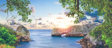 Vivid landscape of beach and coast with mountains and vegetation Stock Photography