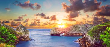 Vivid landscape of beach and coast with mountains and vegetation Stock Image