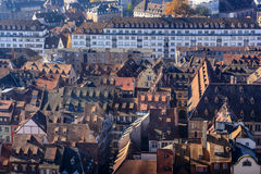 Vivid medieval house roofs covered traditional red and orange tiles in Strasbourg city Stock Images