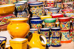 Vivid Mexican Pottery. Colorful Mexican pottery and ceramics at a streetside shop Royalty Free Stock Photography