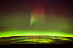 Vivid. Northern lights shows over farmland Royalty Free Stock Photos