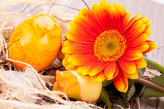 Vivid orange Easter egg with a gerbera and rose Royalty Free Stock Photos