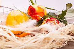 Vivid orange Easter egg with a gerbera and rose Stock Images