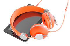 Vivid orange headphones and black tablet pc Stock Image