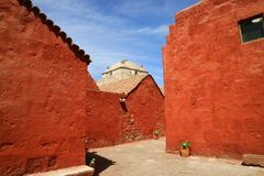Vivid orange red colored of the nun living quarter in Santa Catalina Monastery, UNESCO world heritage site in Arequipa, Peru. Texture background america royalty free stock photography