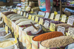Vivid oriental central asian market with bags full of various sp Royalty Free Stock Images