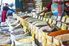 Vivid oriental central asian market with bags full of various sp Stock Photo