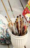 Vivid paintbrushes at the atelier Royalty Free Stock Image