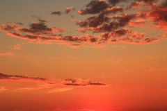 Vivid peach sunset sky Stock Photography