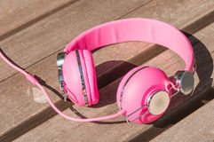 Vivid pink wired headphones Royalty Free Stock Image