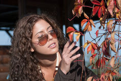 Vivid portrait and autumn leaves Stock Photography