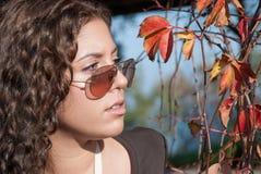 Vivid portrait and autumn leaves Stock Photos
