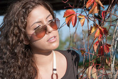 Vivid portrait and autumn leaves Royalty Free Stock Photography