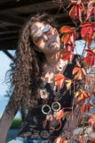 Vivid portrait and autumn leaves Royalty Free Stock Images