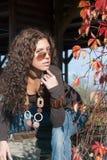 Vivid portrait and autumn leaves Stock Images