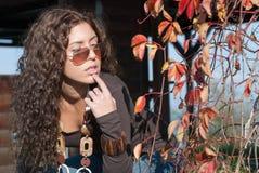 Vivid portrait and autumn leaves Stock Image