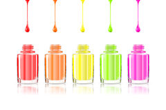 Vivid Rainbow nail polish bottles. Multicolored drips isolated on white background. Vector illustration eps10: mesh and gradient. Colourful Manicure. For Royalty Free Stock Photos
