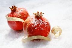 Vivid red Christmas pomegranates Stock Photo