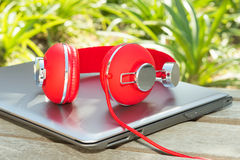 Vivid red headphones and laptop Royalty Free Stock Image