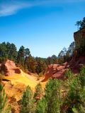 The vivid red ocher Cliffs in Roussillon, France Stock Photography