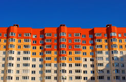 Vivid red and orange apartment house Stock Photography