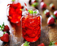 Vivid red strawberry cocktail in a jar. Close up Royalty Free Stock Photography