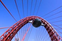 Vivid red suspension. Bridge over blue sky Stock Images