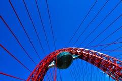 Vivid red suspension bridge. Outdoor Royalty Free Stock Photo