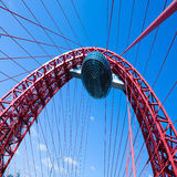 Vivid red suspension bridge. In vivid colors Royalty Free Stock Image