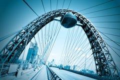 Vivid red suspension bridge. In blue colors Stock Photos